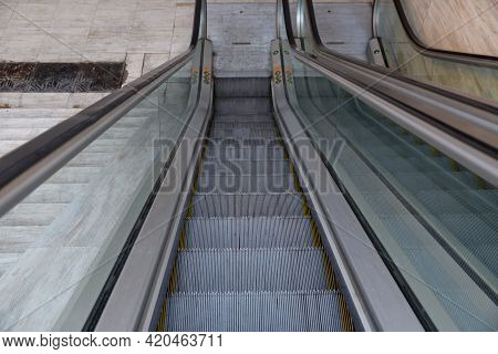 Steps Of The Escalator Close-up . Escalator Stairs To An Underground Subway Station .