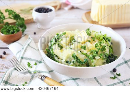 Mashed Potatoes With Fried Savoy Cabbage, Breton Butter And Parsley Dressing On Light Background