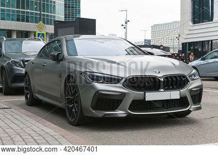 Front View Of Bmw M8 Gran Coupe Is In A Parking Lot Against City Landscape. Moscow, Russia - May 202