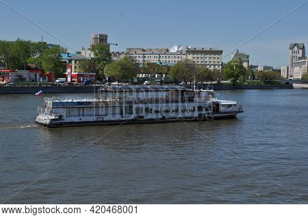 A Pleasure Ship Sails Along The River. River Excursion. Panoramic View Of The Moskva River. May 11,