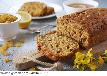 Traditional English Tea Raisins Cake, Egg-free Cake And Cup Of Lemon Tea. Five Clook Tea