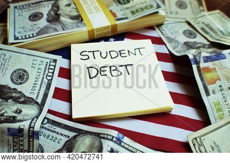 Student Loan Tuition Debt In The United States Concept With Borrowed Money On The American Flag Accu