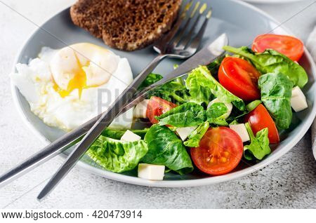 Morning Spring Table Setting Decoration. Salad In Plate, Egg, Cup Of Coffee And Croissant , Fresh Tu