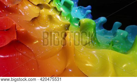 Liquid Gradient Rainbow Color. Bright Glossy Paint Surface As Abstract Festive Background. Glitters