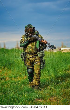 Russian Soldier In Military Uniform Holding A Weapon In His Hands