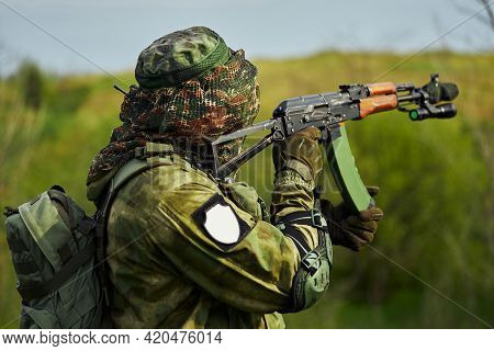 Close-up Of A Russian Soldier Holding A Weapon In His Hands