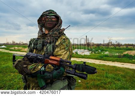 Airsoft Player In The Uniform Of A Russian Soldier Holding A Weapon In His Hands