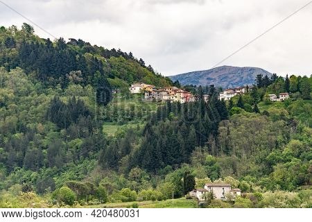 Small Medieval Town. On A High Hill In The Tuscan Mountains Is An Old Italian Town. Spring In May In