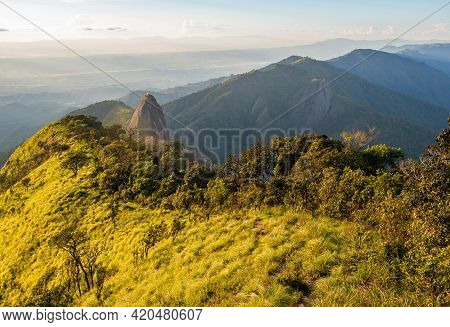 View Of Doi Nork At Sunset. Doi Nork Is Iconic Huge Grey Black Rock In Doi Luang National Park In Ph