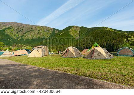 Camping Tents In Fuji-hakone-izu National Park. Lake Tanuki Campground In Fujinomiya City, Shizuoka