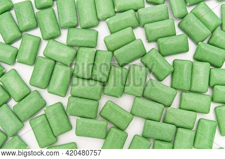 Green Mint Chewing Gum Tablets Scattered Randomly. Isolated On White Background. Top View.