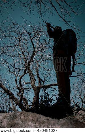 Boy Standing In Front Of Horror Looking Walnut Tree
