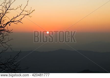 sunset from top of mountain in himachal pradesh, India