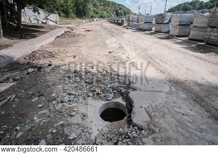 Manhole Near Reconstruction Road Without Signs. Open Sewer.