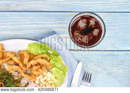 Peruvian Food: Fish Ceviche And Chicharron De Pescado With Fried Cassava, Sweet Corn And Sweet Potat