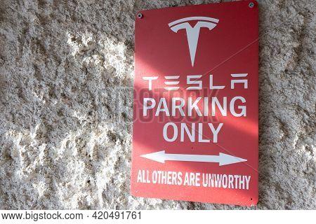 Bordeaux , Aquitaine France - 05 08 2021 : Tesla Parking Only Text Brand Car Store Dealership Logo S