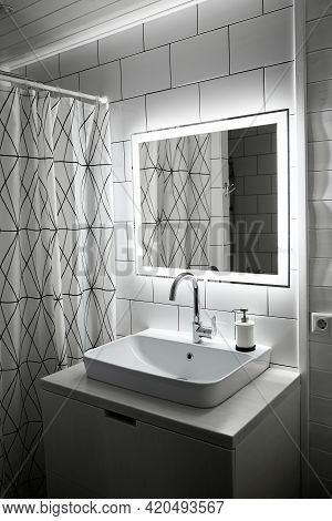 Bathroom In White Color. Large Washbasin. Mirror With Built-in Diode Tape Illumination Switching By