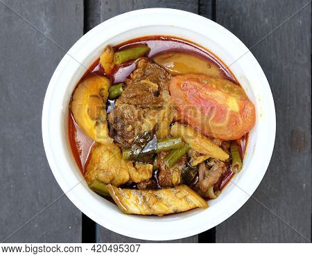 Flatlay Picture Of Beef Dalca Served During Eid Mubarak. Dalca Is A Stewed Vegetable Curry With Lent