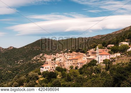 Lenticular Clouds Hang Over The Mountains Behind The Village Of Costa In The Balagne Region Of Corsi