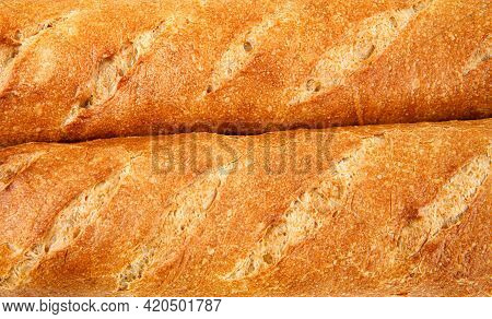 French Baguette. A Background Of Two Baguettes. Art Bread.