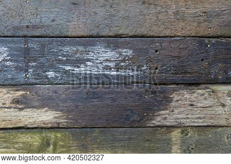 Abstract Background Of Damp Stacked Wooden Railway Sleepers Covered With Frost