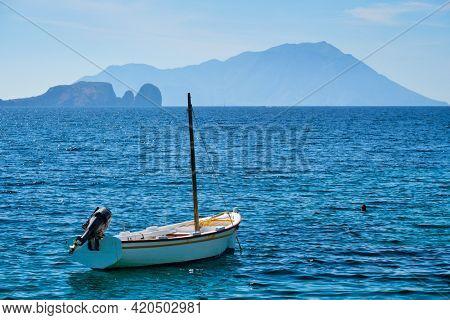 Traditional greek fishing boat in the Aegean sea, Milos island, Greece