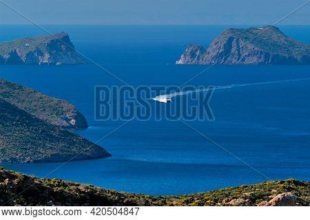 Speeding speed boat catamaran ferry vessel in Aegean sea near Milos island on summer day in Greece