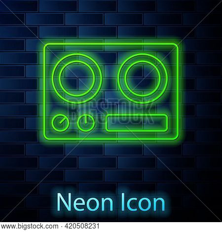 Glowing Neon Line Gas Stove Icon Isolated On Brick Wall Background. Cooktop Sign. Hob With Four Circ