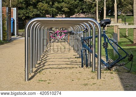 Beautiful Closeup Low Ground View Of Bike Parking Rack Tubes Aligned In Row As Tunnel On University