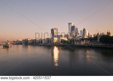 View Of Riverbank Thames River Against Skyscrapers. Urban Skyline Of London At Morning Light , Unite