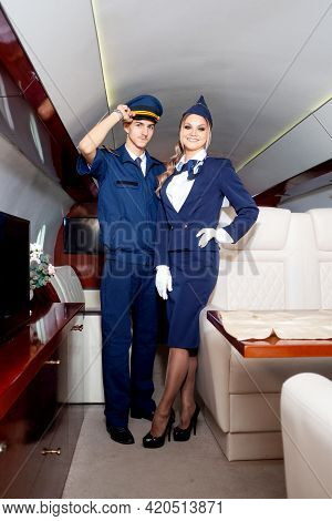Pilot And A Flight Attendant On Board The Plane, The Cabin Of A Private Plane,