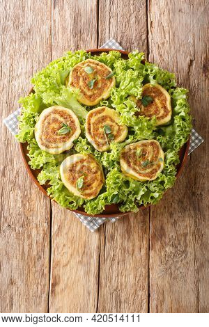 Fleischschnacka Snails Of Meat, This French Recipe From The Alsace Serve With Green Salad Close-up I