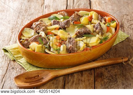 Alsatian Meat And Vegetable Stew Baeckeoffe Close-up In A Pot On The Table. Horizontal