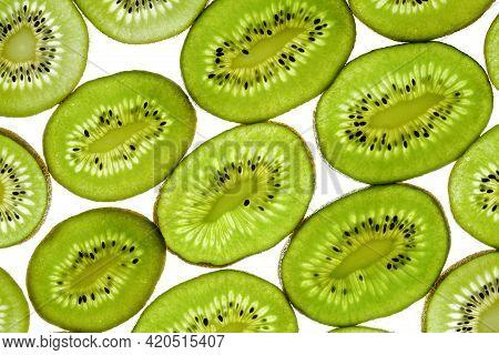 Sliced Kiwi Slices Isolated On White Background, Top View. Fresh Fruit Kiwi Sliced Use For Backgroun
