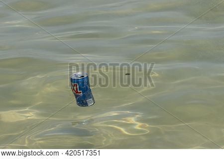 Tel Aviv, Israel - April 15th, 2021: An Empty Soft Drink Can, Floating In The Mediterranean Sea.