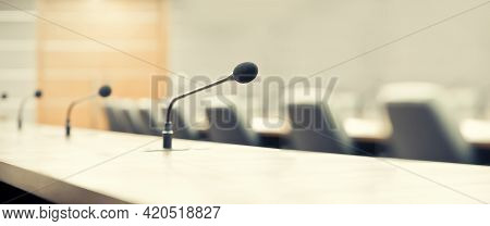 Boardroom And Microphone. Close Up The Conference Microphones On The Meeting Table Or Board Room For
