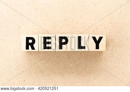 Alphabet Letter Block In Word Reply On Wood Background