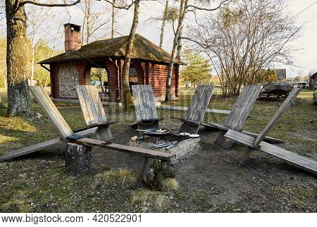 Recreation Area With A Fire Pit In The Courtyard Of A Private House. Wooden Sun Loungers And Benches