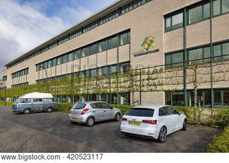 Emmeloord, The Netherlands - May 5, 2021: Facade Modern City Hall Dutch Village Emmeloord With Car P