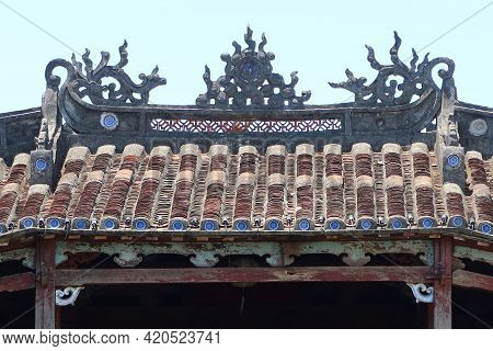 Hoi An, Vietnam, May 15, 2021: Decoration On The Roof Of The Japanese Bridge In Hoi An, Vietnam. One