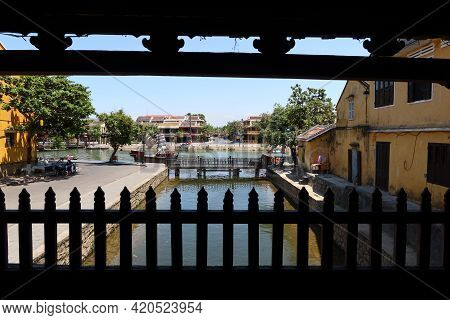 Hoi An, Vietnam, May 15, 2021: View Of The Thu Bon River From Inside The Japanese Bridge In Hoi An,