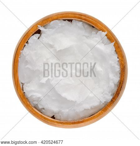 Coconut Oil In A Wooden Bowl. Unrefined Coconut Butter, An Edible Oil, Derived From The Wick, Meat,