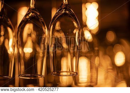 Many Glass Goblets For Champagne, Sparkling Wine, Martini, Alcoholic Drinks Hang Upside Down Above T