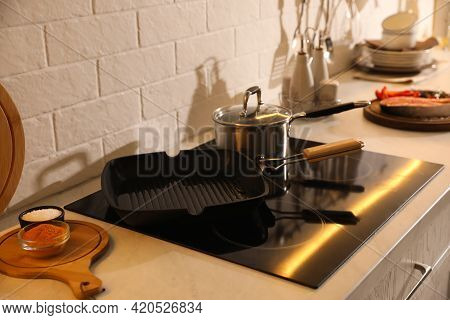 Frying Pan With Cooking Oil On Cooktop
