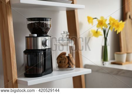 Modern Coffee Grinder And Cookies On Shelving Unit In Kitchen