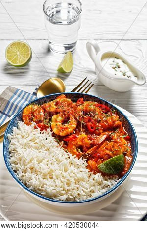 Tomato Prawn Curry With Coriander Sprouts And Red Chili On Top Served With Jasmine Rice And Yogurt G