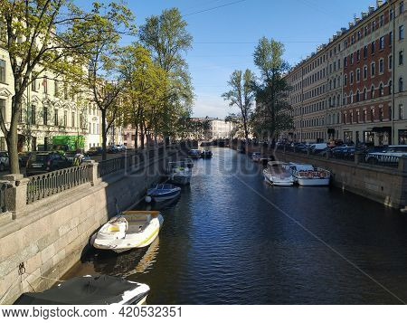 Saint Petersburg, Russia - May 2021. View Of The Granite Embankment Of The Griboyedov Canal With Ple