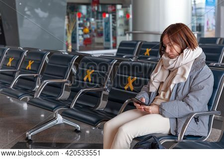 Girl Tourist With Backpack Waiting For Flight In Airport, Horizontal