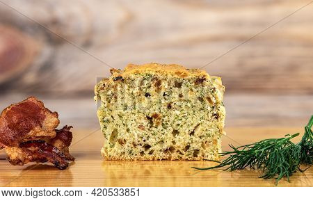 Sliced Muffin With Bacon And Dill On A Cutting Board. Pieces Of Bacon And A Bunch Of Dill.