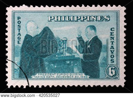 ZAGREB, CROATIA - SEPTEMBER 18, 2014: Stamp printed in Philippines shows President Elpidio Quirino Taking Oath, circa 1950